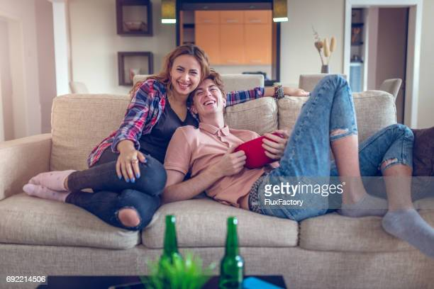 comedy film on tv - romance film stock photos and pictures