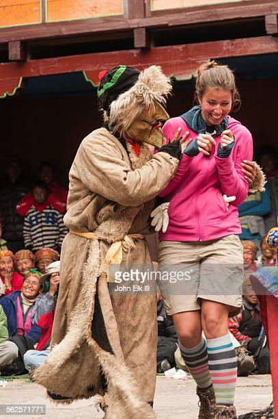 comedy interlude performer with western toursit - mani rimdu festival stock pictures, royalty-free photos & images