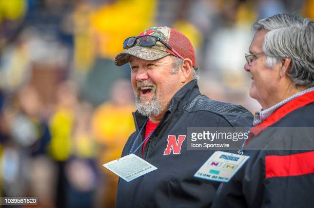 Comedy star 'Larry the Cable Guy' laughs during with friends during pregame warm ups prior to the Michigan Wolverines versus Nebraska Cornhuskers...