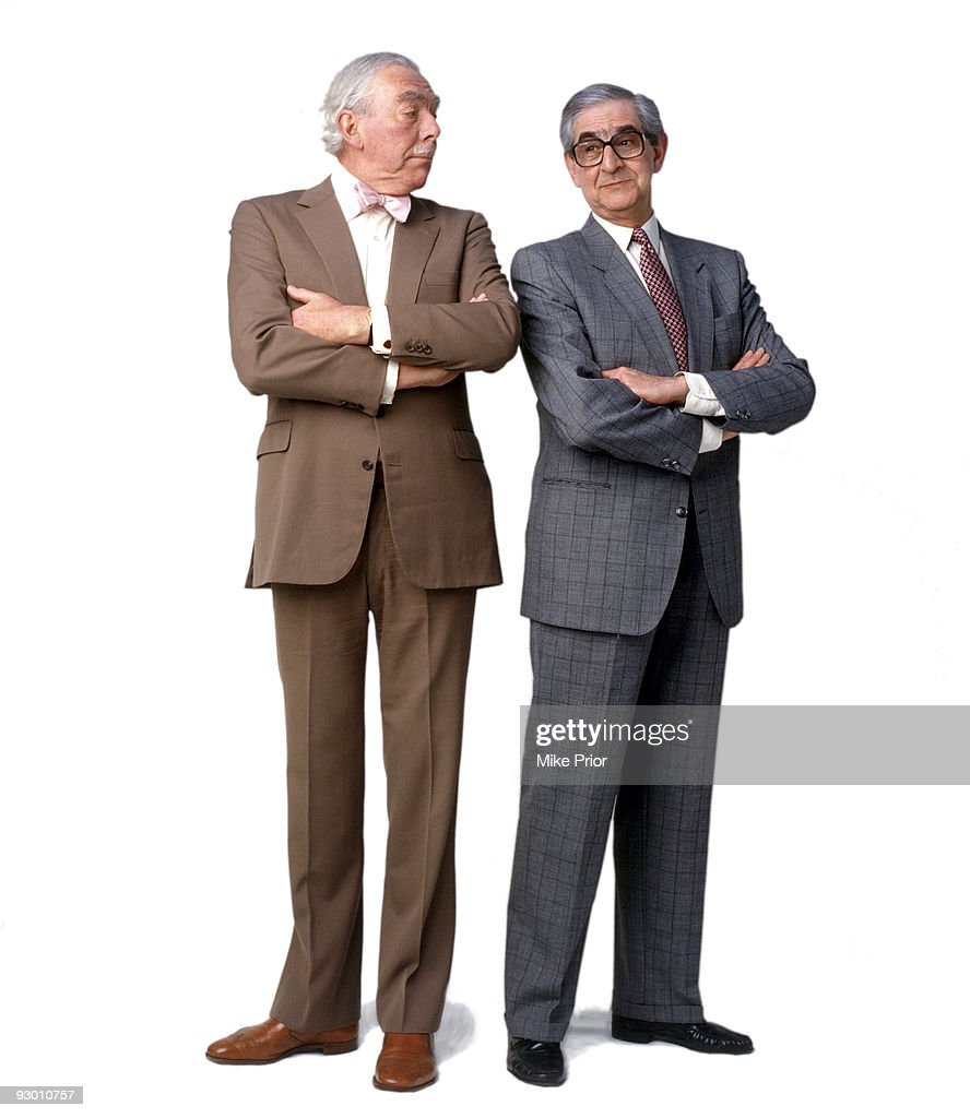 Comedy writing partnership Frank Muir and Denis Norden pose for a studio portrait session in 1993 in London.