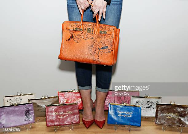 Comes With Baggage Founder Lori Levine shows off her oneofakind orange Hermès Birkin and some pieces from her clutch collection at the Comes With...