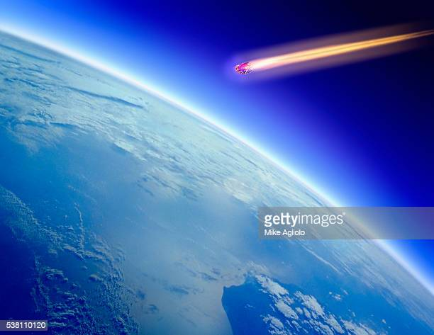 comet flying towards planet - mike agliolo stock photos and pictures
