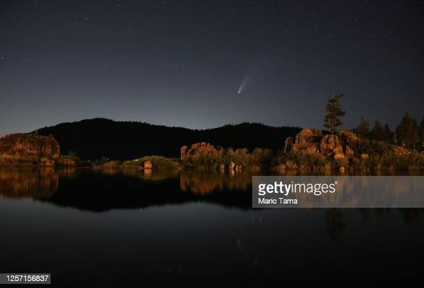 Comet NEOWISE, also known as 'C/2020 F3', is visible above Big Bear Lake after sunset on July 19, 2020 in Big Bear Lake, California. The comet is...