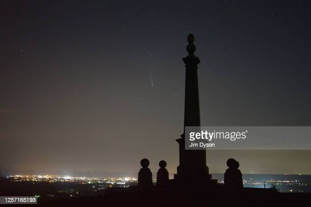 Comet NEOWISE also known as 'C/2020 F3' is visible in the sky behind the Boer War monument at Coombe Hill on July 19 2020 in Aylesbury...