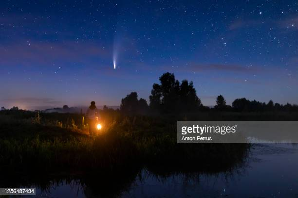 comet neowise c/2020 f3 and woman with a lantern. - orbiting stock pictures, royalty-free photos & images