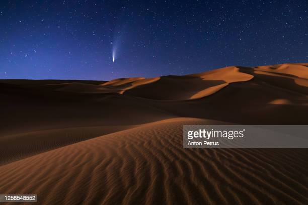 comet neowise c/2020 f3 at night over sand dune in desert - twilight stock pictures, royalty-free photos & images