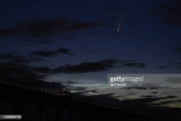 Comet Neowise is visible in the night sky above Saltburn pier on July 13 2020 in Saltburn By The Sea England Comet Neowise officially called C/2020...