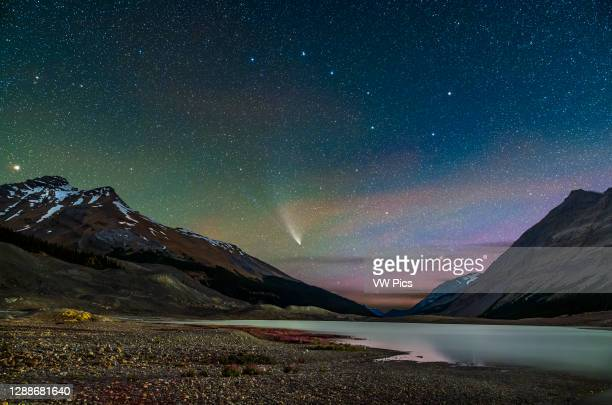 Comet NEOWISE on July 27, 2020 from the Columbia Icefields from the Toe of the Glacier parking lot, looking north over Sunwapta Lake, formed by the...