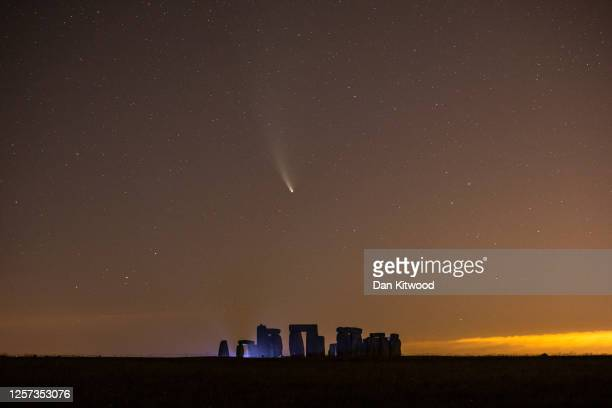 Comet NEOWISE passes over Stonehenge in the early hours of July 21, 2020 in Salisbury, England. Comet NEOWISE, the brightest seen in the Northern...