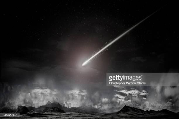 Comet over remote landscape