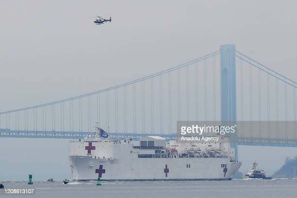 Comfort a floating hospital in the form of a Navy ship arrives in New York City United States on March 30 2020