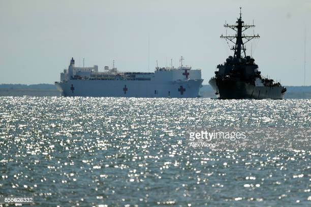 Comfort the naval hospital ship leaves the harbor as USS McFaul is seen in the foreground September 29 2017 in Hampton Virginia The USNS Comfort is...