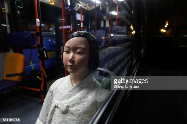 Comfort woman statue installed in a bus ahead of the 72nd Independence Day on August 14 2017 in Seoul South Korea The statue was originally erected...
