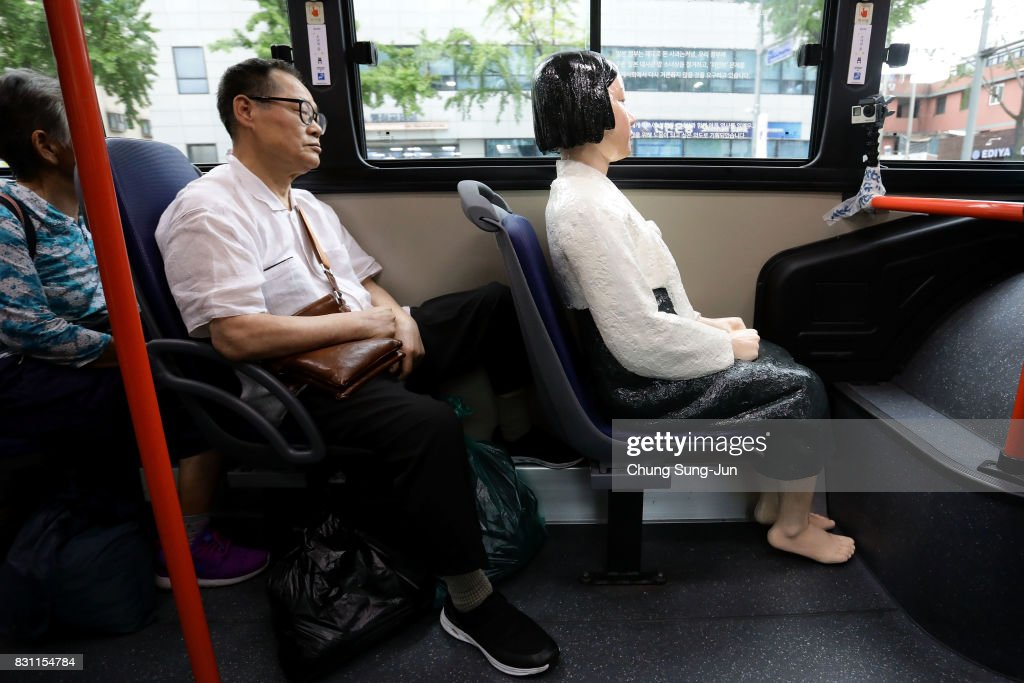 Seoul Bus Runs With 'Comfort Woman' Sex Slave Statue Ahead Of Liberation Day : News Photo