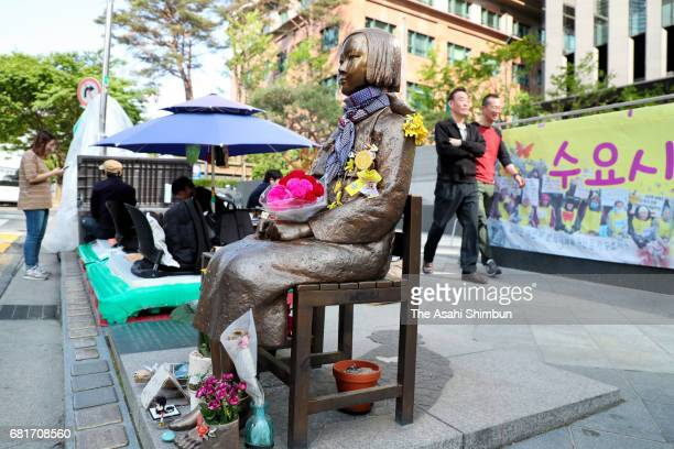 A 'Comfort Woman' statue is seen in front of Japanese Embassy on the day of South Korea's new President Moon JaeIn inauguration on May 10 2017 in...