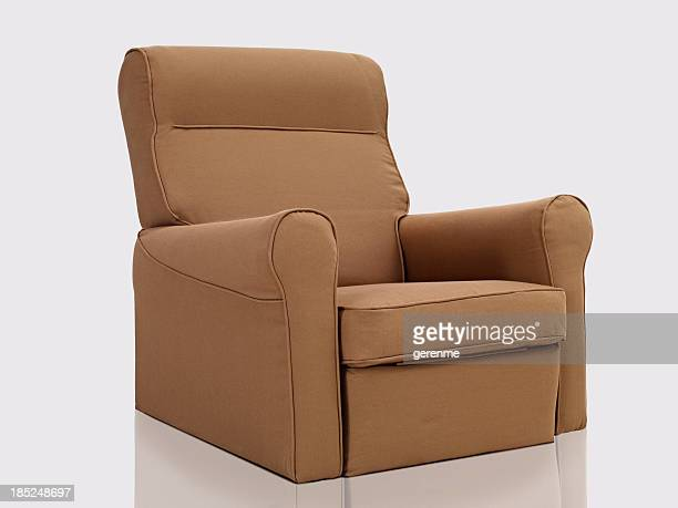 comfortable arm chair - reclining chair stock photos and pictures