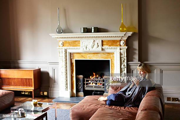 comfortable by the fire - hot older women stock pictures, royalty-free photos & images