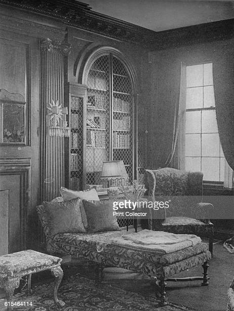 Comfortable corner in the library showing bookcase house of Miss Anne Morgan New York City 1924 Anne Morgan was a wealthy socialite and...