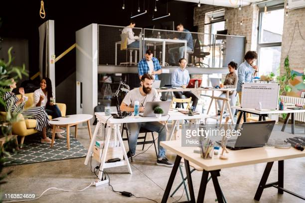 comfortable co-working space, some coworkers arriving at work - new business stock pictures, royalty-free photos & images