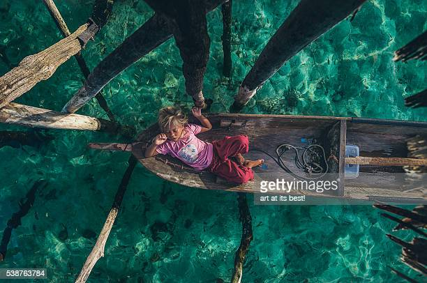 comfortably sleeping on a wooden boat - malaysia beautiful girl stock photos and pictures