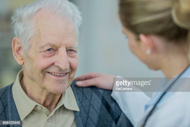 comforting doctor - hospice stock pictures, royalty-free photos & images