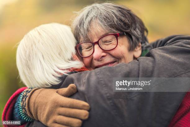 comforting embrace - arm around stock pictures, royalty-free photos & images