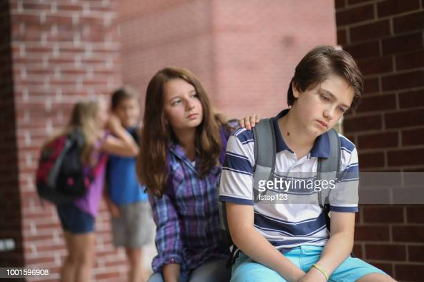 comforting friend after being bullied. - bullying imagens e fotografias de stock