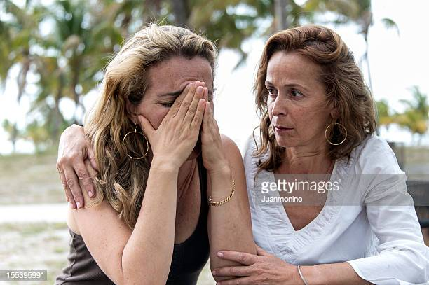 comforting friend - mourning stock pictures, royalty-free photos & images