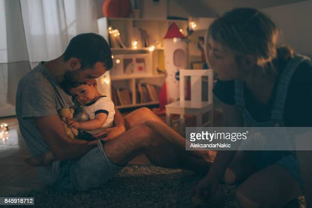 comforting our child - sad mom stock pictures, royalty-free photos & images