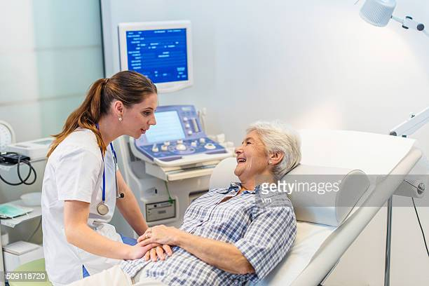 Comforting young female doctor with patient