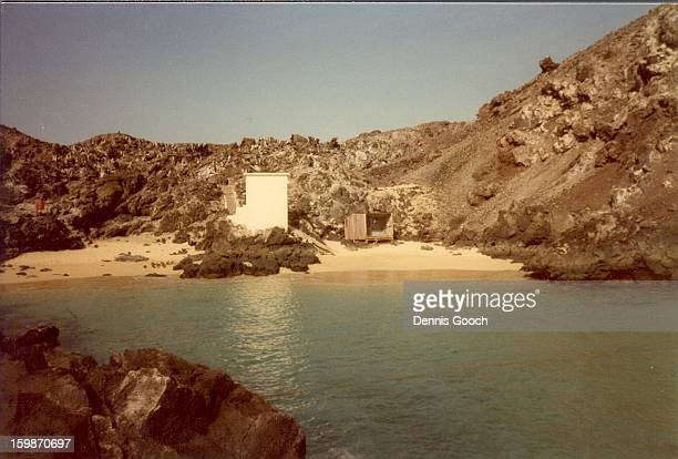 Comfortless Cove Feb 1985. The white building is the Atlantic Cable Building that interfaces the Atlantic cable between South Africa and Europe.A...