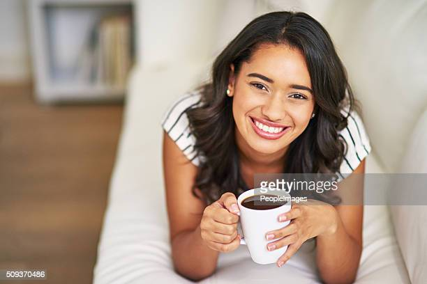 comfy with a little coffee - peopleimages stock pictures, royalty-free photos & images
