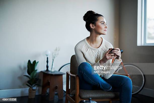 comfy with some coffee - contemplation stock pictures, royalty-free photos & images