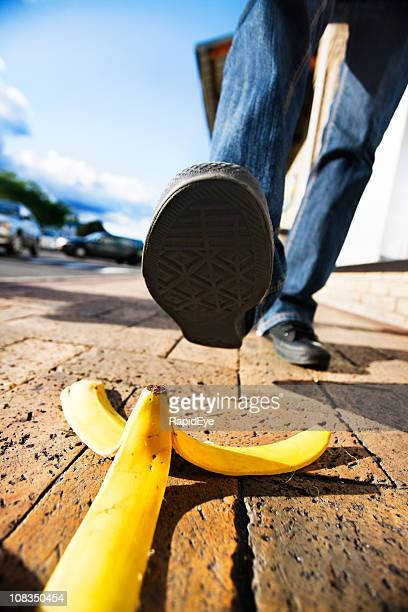 Comic accident classic about to happen: foot approaches banana peel