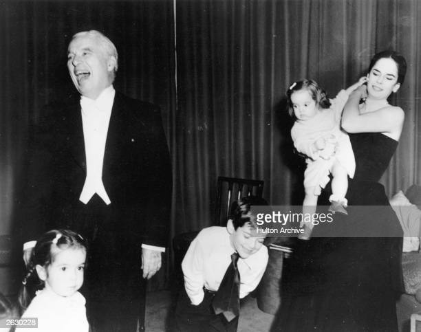 Comic actor and film director Charlie Chaplin with his wife Oona and children Josephine Michael and Victoria at the Savoy Hotel London
