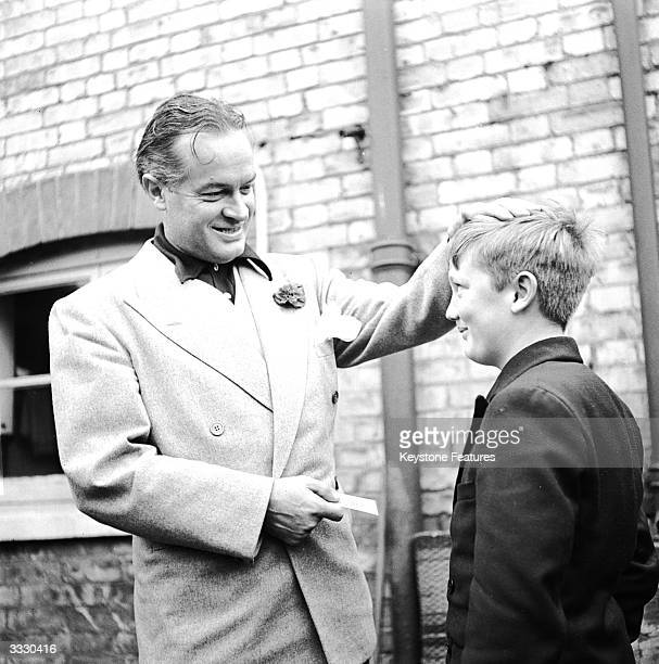 Comic actor Bob Hope has a chat with local boy John Gower, when the Hollywood star visited his family in Hitchin, Hertfordshire.