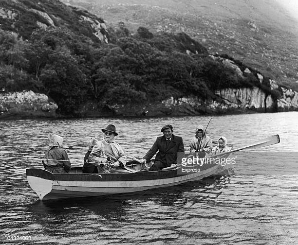 Comic actor Charlie Chaplin and family on a fishing holiday in Killarney, Ireland, 14th July 1960. Chaplin's wife Oona O'Neill is on the far right.