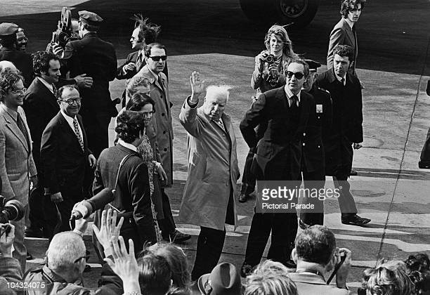 Comic actor Charlie Chaplin arrives at JFK Airport, New York, accompanied by his wife Oona O'Neill , 3rd April 1972. Photographing them is American...