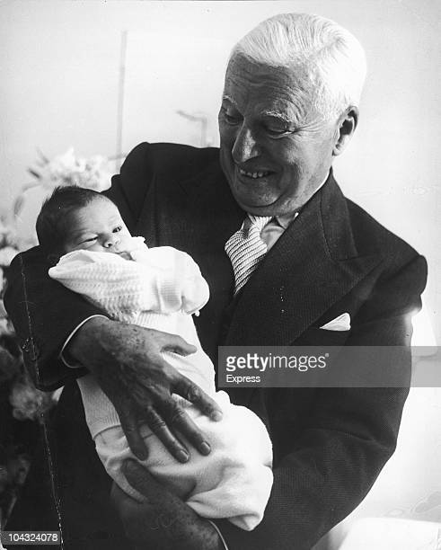 Comic actor Charlie Chaplin holding his weekold son Christopher at the MontChoisi Clinic Lausanne Switzerland 14th July 1962 Christopher is his...