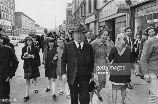 Comic actor Charlie Chaplin out walking with his wife Oona on the Old Kent Road near his birthplace in Southwark London 11th May 1966 Chaplin is in...