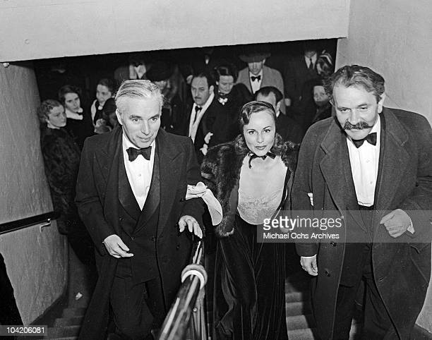 Comic actor Charlie Chaplin with American actress Paulette Goddard and writer Konrad Bercovici Hollywood circa 1935 Bercovici collaborated with...