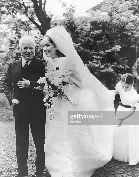 Comic actor Charlie Chaplin with his daughter Josephine during her wedding to Greek businessman Nikki Sistovaris, Lausanne, Switzerland, 23rd June...