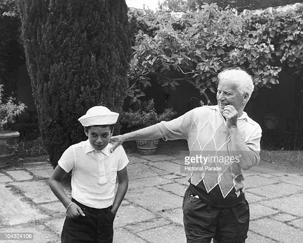 Comic actor Charlie Chaplin with his son Michael on the terrace at their home the Manoir de Ban Switzerland circa 1957