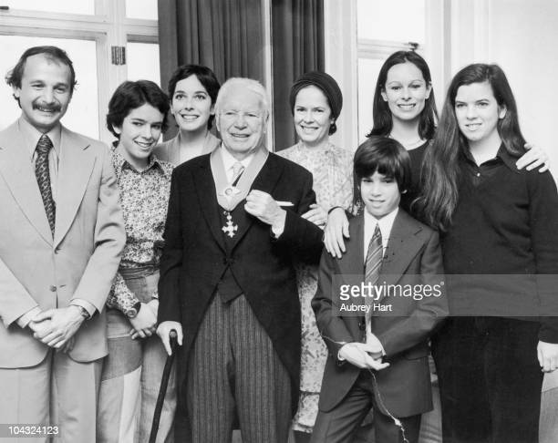 Comic actor Charlie Chaplin with his wife Oona O'Neill and family at the Savoy Hotel London after Chaplin received his knighthood at Buckingham...