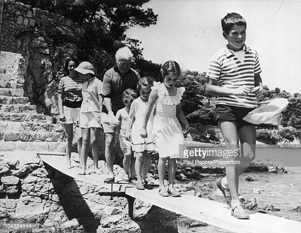 Comic actor Charlie Chaplin with his wife Oona O'Neill and their children on holiday at Cap Ferrat France 15th July 1957 Left to right Oona Geraldine...