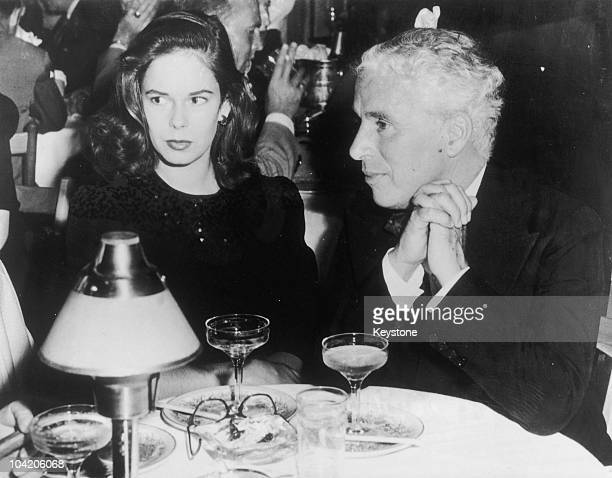 Comic actor Charlie Chaplin with his wife Oona O'Neill at the Mocambo nightclub Hollywood California 7th July 1943