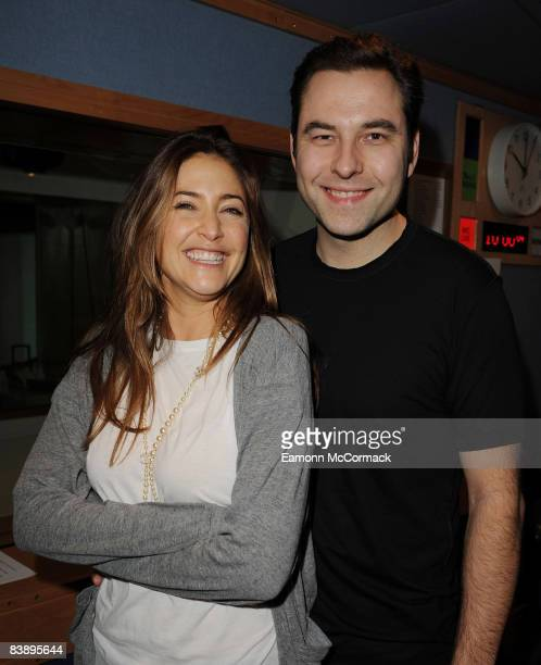 Comic actor David Walliams poses with radio host Lisa Snowdon during his visit to the Capital Radio morning show on December 3, 2008 in London,...