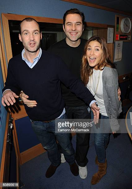 Comic actor David Walliams poses with radio hosts Johnny Vaughan and Lisa Snowdon during his visit to the Capital Radio morning show on December 3,...