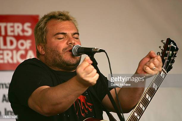 Comic actor Jack Black performs as members of the Writers Guild of America rally outside FremantleMedia North America to call attention to conditions...