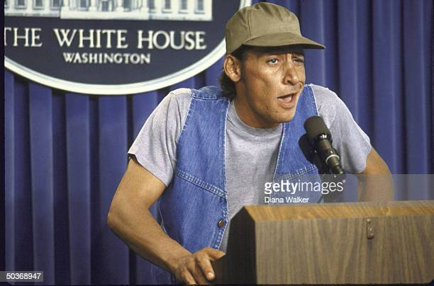 Comic Actor Jim Varney in guise of character Ernest P Worrell giving surprise briefing at White House